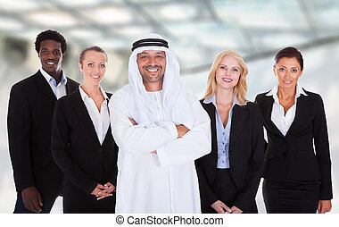 Arabic Man Standing With Businesspeople - Portrait Of Arabic...