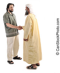 Arabic Muslim businessman shaking hands