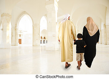 Arabic Muslim family walking indoor