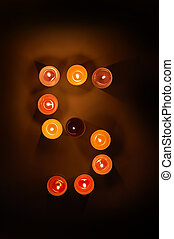arabic numer 5 from candles
