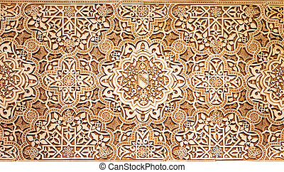 arabic pattern texture at Alhambra palace in Granada, Spain