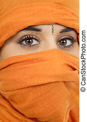 arabic - young woman with a veil close up portrait studio...