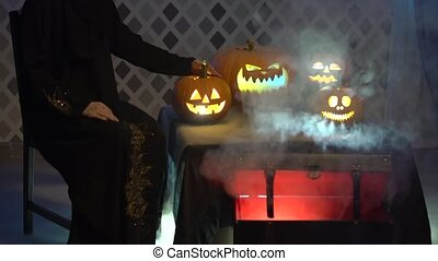 Arabic woman in abaya dances, celebrate halloween with scary...