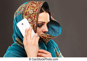 Arabic woman talking on smartphone