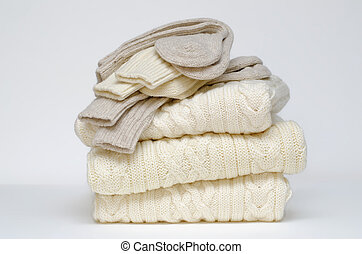 Aran knit sweaters and socks - A stack of pure wool sweaters...