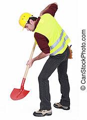 arbeider, graven, met, een, schop
