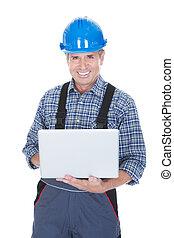 arbeider, vervelend, harde hoed, en, gebruikende laptop