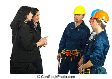 arbetare, kvinnor, affär, konversation