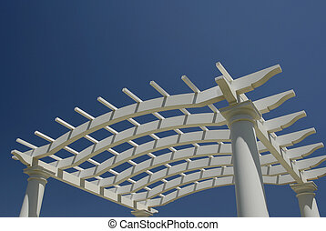 Arbor - A white arbor isolated against a blue sky