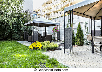 Arbor with wicker furniture - Horizontal view of arbor with ...