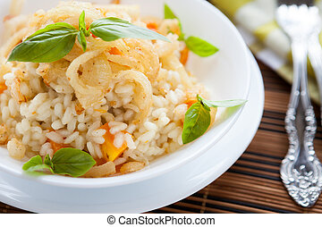 Arborio rice with onions in a white bowl