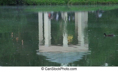 Arbour, reflected in the water