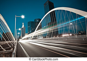 Arc bridge girder highway car light trails city night...