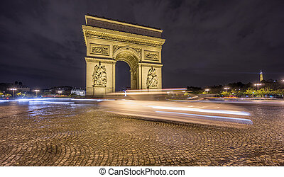 Arc de Triomphe and blurred traffic at night