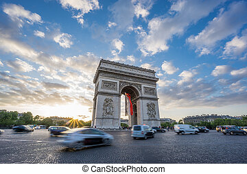 Arc de Triomphe and blurred traffic at sunset - Sunset with...