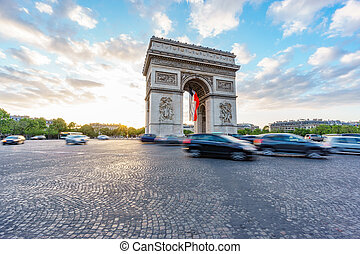 Arc de Triomphe and blurred traffic at sunset, wide angle