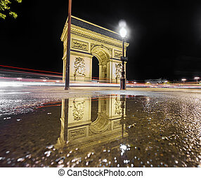 Arc de Triomphe and reflection at night