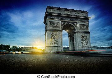 Arc de Triomphe at night. Beautiful sunset over Place de l'Etoile, Paris