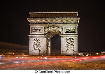 Arc de Triomphe at night in Paris
