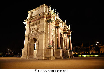 Arc de Triomphe at the Place du Carrousel in Paris in the night. View from the corner.