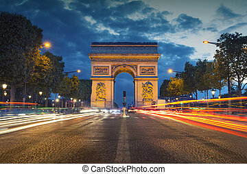 Image of the iconic Arc de Triomphe in Paris city during twilight blue hour.
