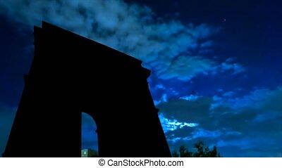 Arc De Triomphe night sky and moon - TIME LAPSE: dark sky...