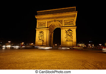 Arc de Triomphe on the Charles de Gaulle square at night.
