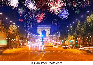 Arc de triumph at Paris and fireworks in night sky
