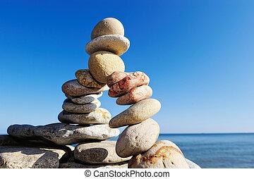 Arc of pebbles