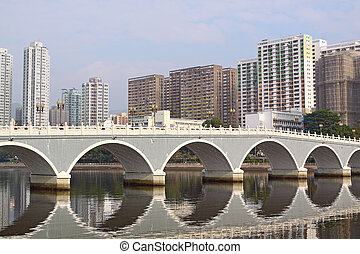 Arch bridge in asia downtown area, hong kong