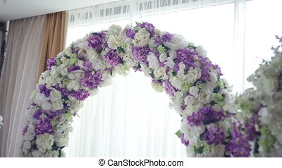 Arch for the wedding ceremony. Arch decorated with natural flowers