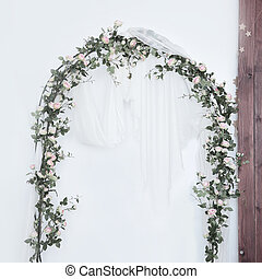 Arch for the wedding ceremony, decorated with cloth and flowers