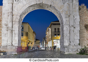 Arch of Augustus at night in Rimini, Italy