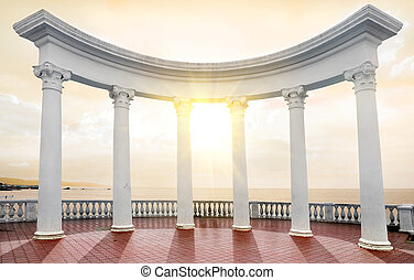 Arch on a seafront - White arch with columns on a seafront