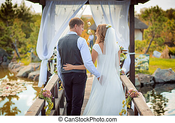 arch wedding ceremony, decorated with cloth flowers greenery...