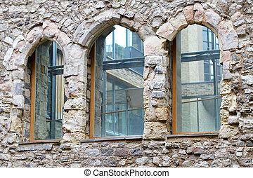 Closeup architecture detail with windows on stone house