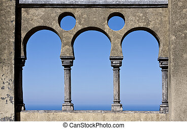 Open arch windows with a panoramic view of the blue open sky - Portugal, Sintra