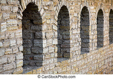 Part of the wall old castle with arch windows