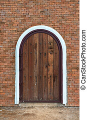 arch wooden door with brick building