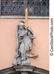 Archangel Michael on the portal of Dreifaltigkeitskirche ( Holy Trinity ) church in Graz, Austria