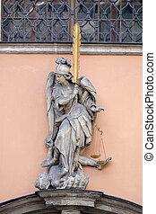 Archangel Michael on the portal of Dreifaltigkeitskirche ( Holy Trinity ) church in Graz, Austria