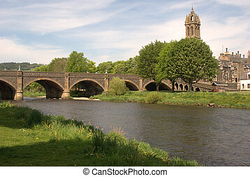 arched bridge over river Tweed and church tower at Peebles in summer