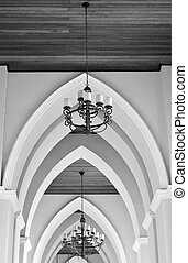 arched ceiling of church with chandelier in black and white