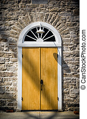 Arched Door in Old Stone Wall - An arched doorway set in an...
