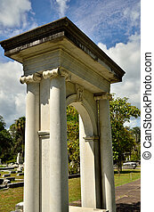 Arched monument - Arched memorial rises strongly above other...