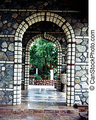 Arched Passageway - Arched doorway into a lush green garden