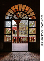 arched spanish door at mexican anbandoned medieval hacienda...