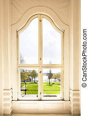 Arched Window - An old arched window view out to a garden