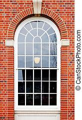 Arched window brick wall