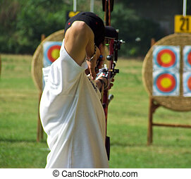 archer aiming at target during official competition